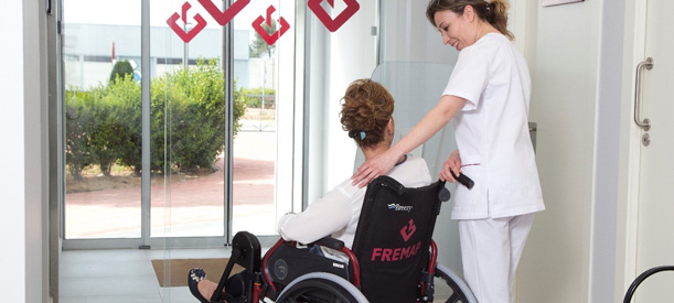 Decorative image, girl pushing to patient in wheelchair